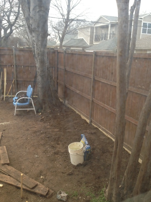 The fence is finished being repaired (so we put 15,000 lbs of decomposed granite against it!)
